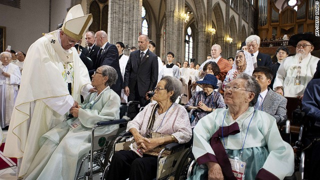 "This handout picture released by the Osservatore Romano shows Pope Francis (L) meeting with former ""comfort women"", Koreans forced to work in Japanese wartime military brothels, prior to celebrate a mass for peace and reconciliation at the cathedral on August 18, 2014 in Seoul. Pope Francis wrapped up the first papal visit to Asia in 15 years on August 18, urging the divided Koreas to reject suspicion and confrontation and unite as ""one family, one people"".   AFP PHOTO / OSSERVATORE ROMANO -RESTRICTED TO EDITORIAL USE - MANDATORY CREDIT ""AFP PHOTO / OSSERVATORE ROMANO"" - NO MARKETING NO ADVERTISING CAMPAIGNS - DISTRIBUTED AS A SERVICE TO CLIENTS"