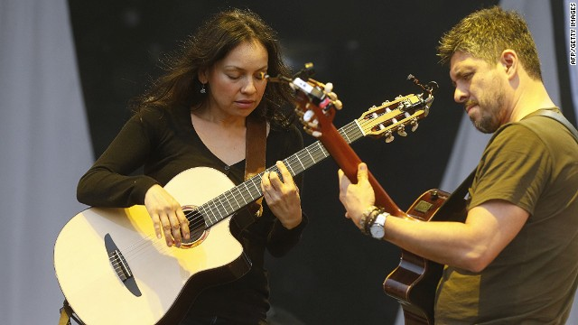 Gabriela Quintero (L) and Rodrigo Sanchez of the Mexican band 'Rodrigo y Gabriela' perform on stage during the Solidays music festival in Paris on June 28, 2014. AFP PHOTO / THOMAS SAMSONTHOMAS SAMSON/AFP/Getty Images