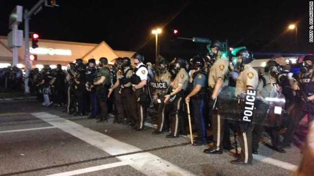 Protests unfold in Ferguson late Monday, August 18, 2014.