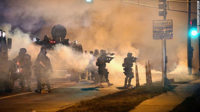 Police attempt to control protesters in the streets of Ferguson, Missouri, on Monday, August 18.