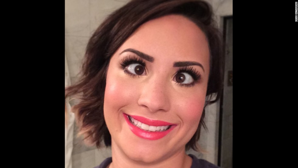 "Actress and singer Demi Lovato <a href=""http://instagram.com/p/rvOGfAuKk0/"" target=""_blank"">posted this silly selfie</a> to Instagram on Friday, August 15, with the message: ""6 am glamour-puss."" She included the hashtag ""#votedemilovato"" as her ""Really Don't Care"" video is <a href=""http://www.mtv.com/ontv/vma/2014/best-lyric-video/ "" target=""_blank"">up for an MTV Video Music Award.</a>"