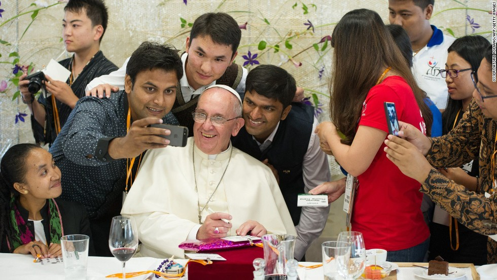 """Pope Francis poses for a selfie as he meets young people in Daejeon, South Korea, on Friday, August 15. The Pope's <a href=""""http://www.cnn.com/2014/08/13/asia/gallery/pope-francis-south-korea/index.html"""">trip to South Korea</a> marks the first papal visit to the country since Pope John Paul II went there 25 years ago."""