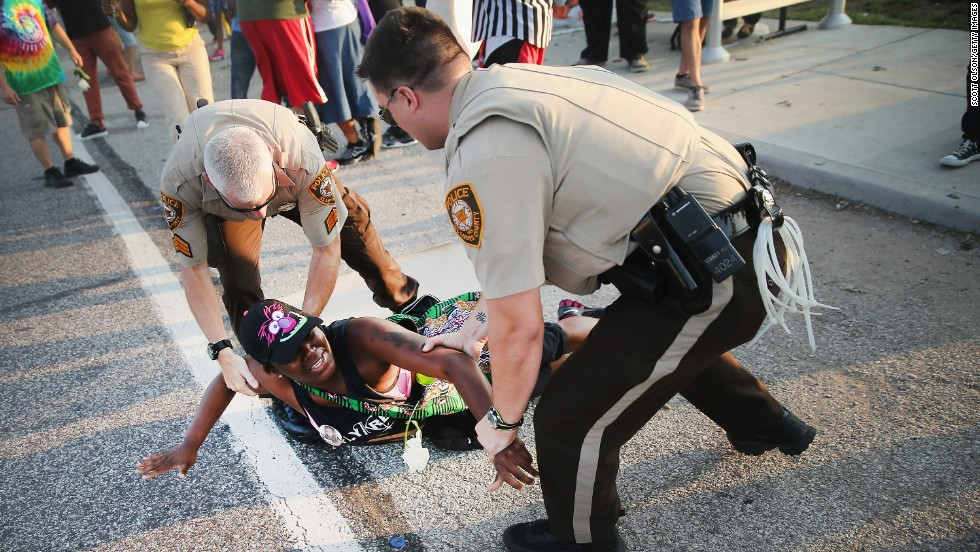 A demonstrator is arrested on August 19, 2014.