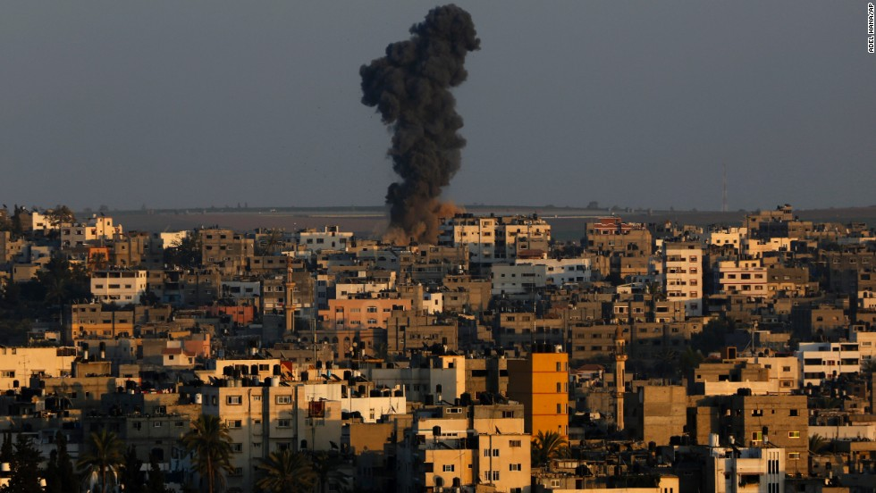 Smoke rises after an Israeli airstrike on Gaza City on August 19.