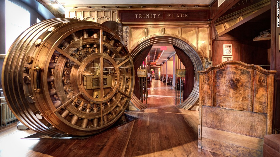 A set of two century-old 35-ton doors lead to the former underground vaults of the United States Realty Bank in New York. The first room of Trinity Place is a buzzy lounge area, while the second is a dining room.