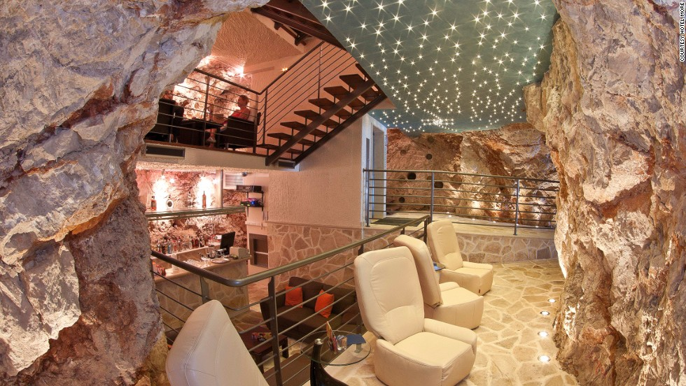 In the heart of Bar More in Dubrovnik, you'll find rocky walls illuminated purple, stalagmites and stalactites, glossy white bar counters and some serious mixology from the bartenders.
