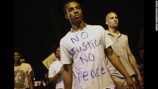 Demonstrators protest in Ferguson on August 20.
