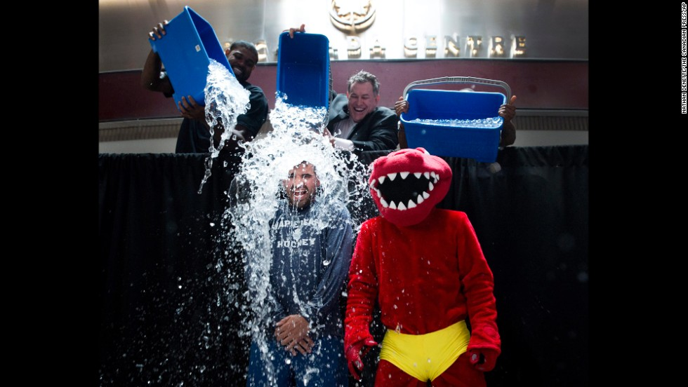 "Nazem Kadri, a professional hockey player with the NHL's Toronto Maple Leafs, has water dumped on him as he and the mascot of the NBA's Toronto Raptors participate in the ALS Ice Bucket Challenge on Wednesday, August 20. Many celebrities <a href=""http://www.cnn.com/2014/08/18/showbiz/celebrity-news-gossip/ice-bucket-challenge-celebs/index.html"">have joined in the viral Internet campaign</a> to raise money and awareness for Lou Gehrig's disease, which is also called amyotrophic lateral sclerosis, or ALS."