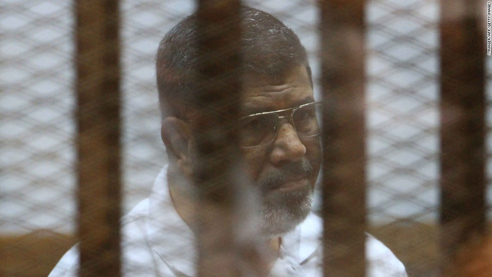Former Egyptian President Mohamed Morsy sits inside a cage during his trial in Cairo on Monday, August 18. Morsy has faced a variety of charges since he was removed from office in a coup last year.