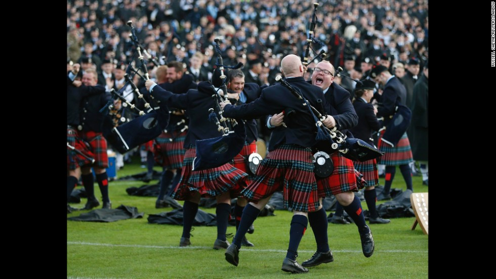 Members of the Field Marshal Montgomery Pipe Band react to winning the annual World Pipe Band Championships in Glasgow, Scotland, on Saturday, August 16.