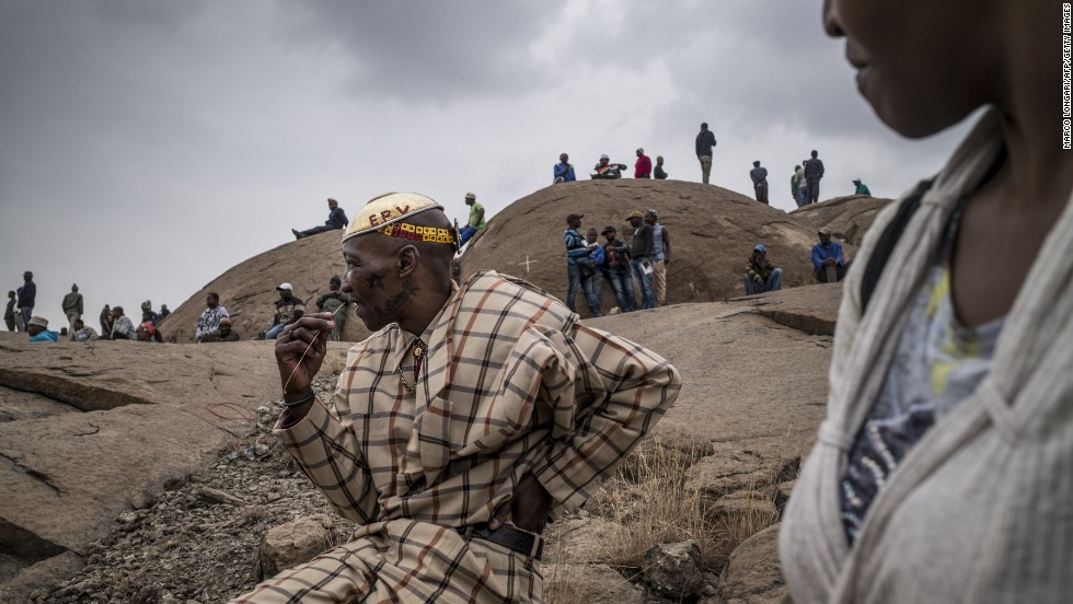 "People gather Saturday, August 16, at a mine in Marikana, South Africa, where 34 striking workers were <a href=""http://www.cnn.com/2013/08/15/world/africa/mabuse-marikana-noki/index.html"">fatally shot by police</a> two years ago. Police said they acted in self-defense against a mob of miners armed with clubs and machetes."