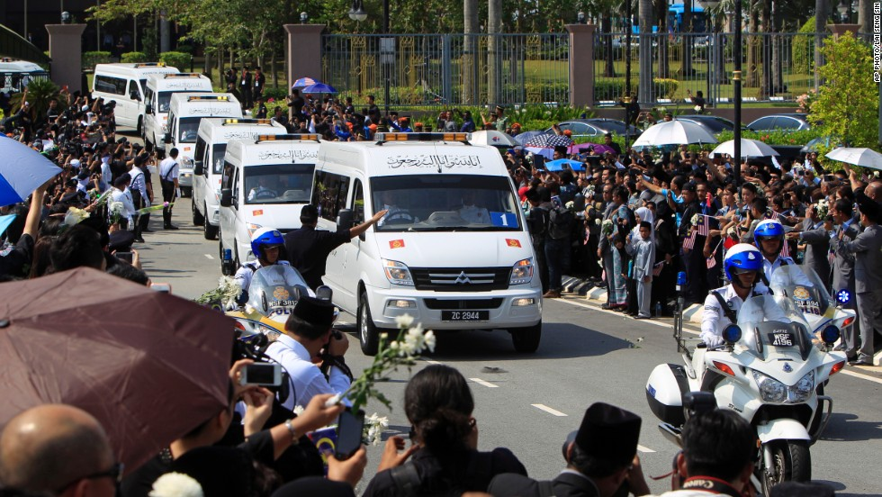 Hearses carrying victims' bodies leave Kuala Lumpur's international airport.