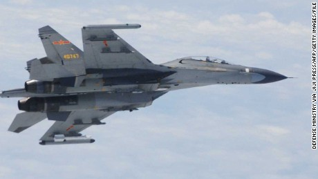 "This picture taken and released by Japan's Defence Ministry on June 11, 2014 and received via Jiji Press shows one of two Chinese Su-27 fighter jets which flew ""dangerously"" close to two Japanese military planes over the East China Sea. Japan accused China of flying fighter jets ""dangerously"" close to two of its military planes over the East China Sea on June 11, as bilateral tensions simmer over the countries' territorial dispute. On June 12, Japan summoned the Chinese ambassador to complain about the fighter jets activities.    JAPAN OUT     AFP PHOTO/Defense Ministry via Jiji Press --- EDITORS NOTE -- RESTRICTED TO EDITORIAL USE - MANDATORY CREDIT ""AFP PHOTO / AFP PHOTO/Defense Ministry via Jiji Press""- NO MARKETING NO ADVERTISING CAMPAIGNS - DISTRIBUTED AS A SERVICE TO CLIENTSJIJI PRESS/AFP/Getty Images"