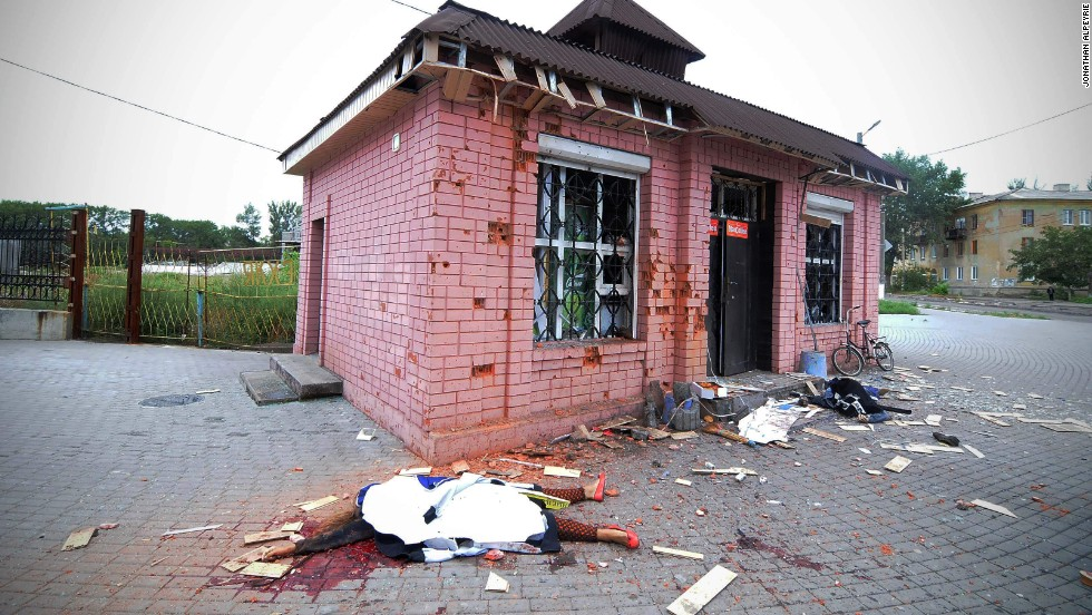 A shell killed two shop keepers outside their store.