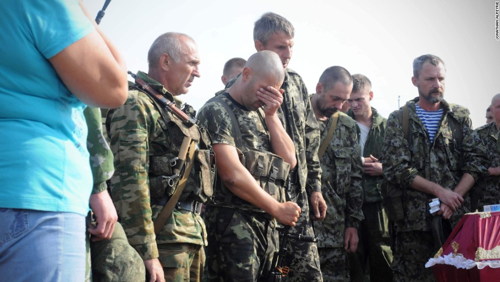 Photojournalist Jonathan Alpeyrie took a series of images of pro-Russian rebels burying four fallen fighters in Ukraine, August 18.