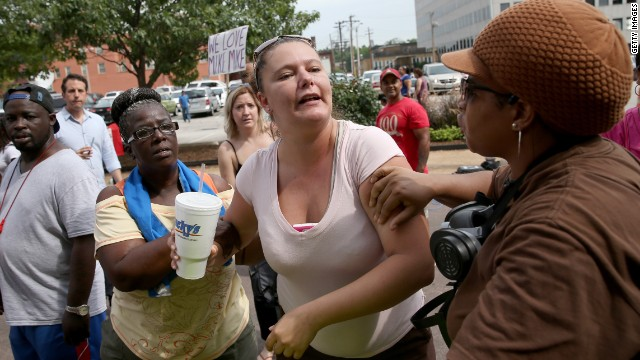 White and black protesters clash in Ferguson during demonstrations that have divided the nation.