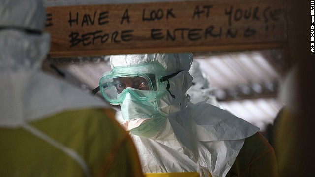 A member of Doctors Without Borders prepares to enter a high-risk area of an Ebola treatment center in Liberia.