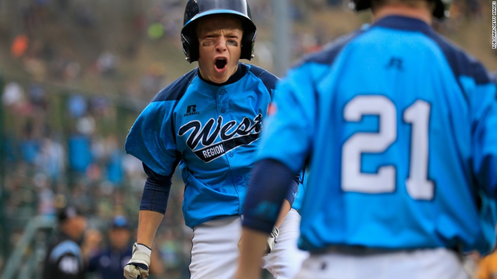 Justin Hausner of the West team from Las Vegas celebrates after scoring a first inning run against the Great Lakes Team from Chicago on August 23.