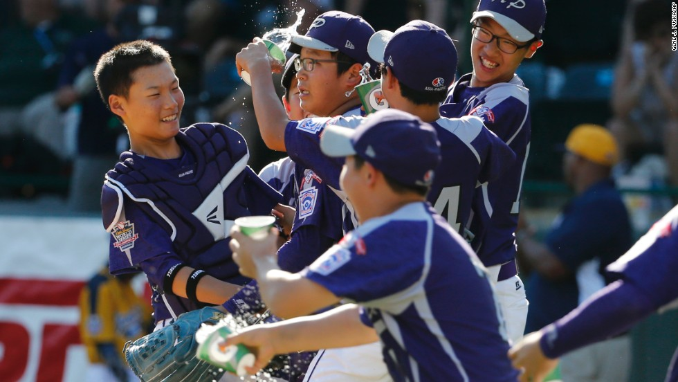 South Korea's Hae Chan-choi, center, celebrates with teammates after getting the final out of a 8-4 win against Chicago.