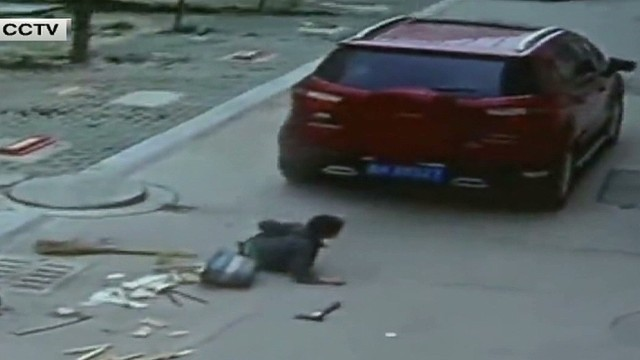 cnnee cafe oraa china boy being run over by car_00000905.jpg