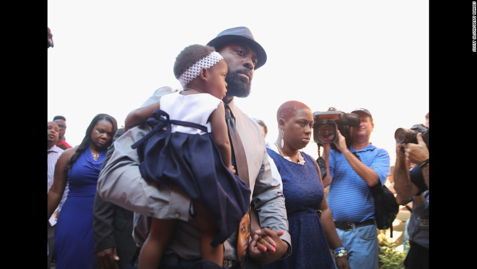 Brown's father, Michael Brown Sr., arrives for the funeral.
