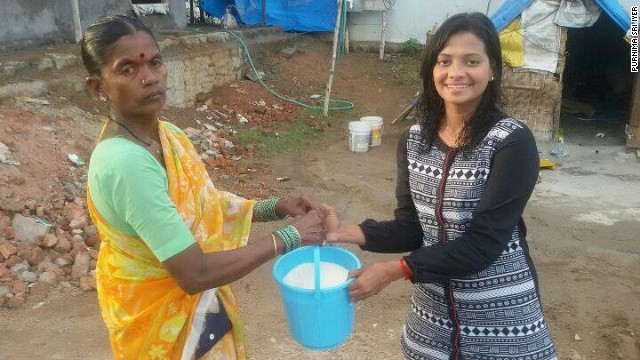 Purnima Sri Iye (right), a journalist at Metro India, is among the first to donate rice as part of the Rice Bucket Challenge.