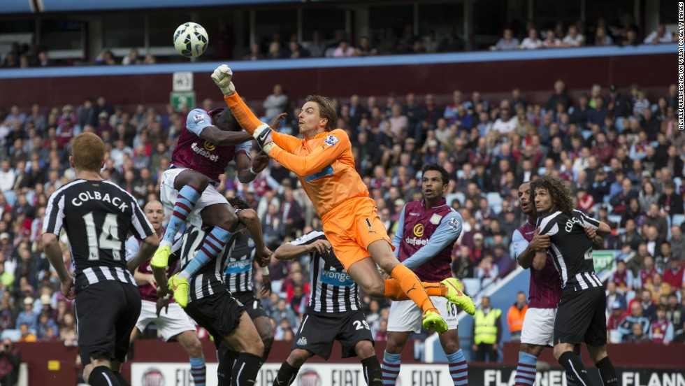 Tim Krul of Newcastle United challenges Aly Cissokho of Aston Villa during a Barclays Premier League match on Saturday, August 23, in Birmingham, England. The game ended 0-0.