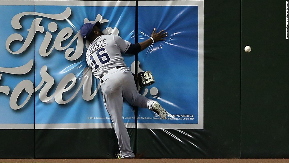 Outfielder Abraham Almonte of the San Diego Padres crashes into the wall while attempting to catch a ball hit by Miguel Montero of the Arizona Diamondbacks on Friday, August 22, in Phoenix. The Diamondbacks defeated the Padres 5-1.