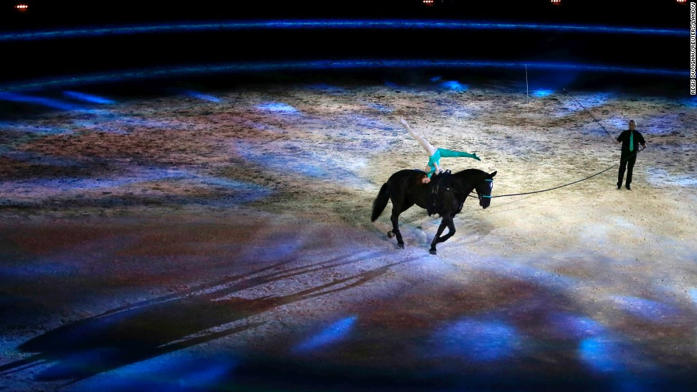 A rider and artist perform during the opening ceremony of the World Equestrian Games in Caen, France, on Saturday, August 23.