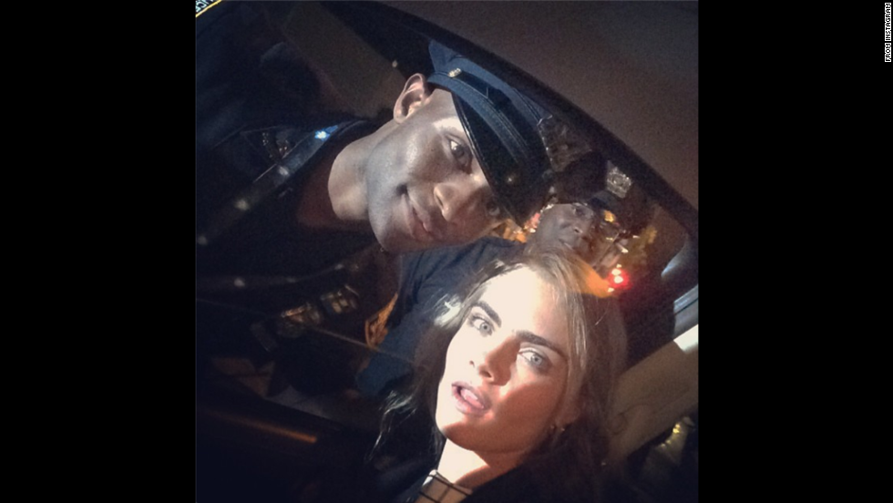 "English fashion model Cara Delevingne was spotted in New York  taking selfies with the NYPD. She later posted this selfie to her Instagram account with the message, ""See you next time <a href=""http://instagram.com/ra_718"" target=""_blank"">@ra_718</a> #Esson"""