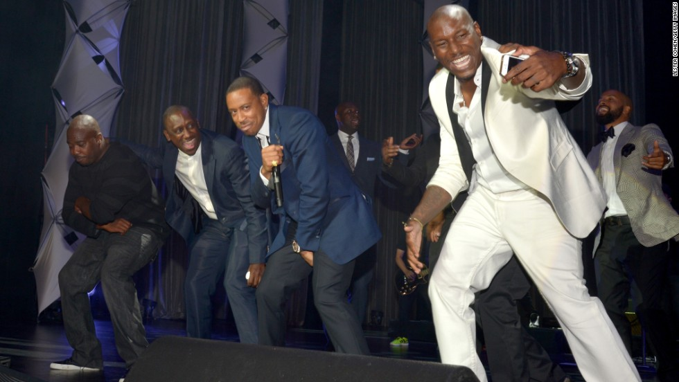 "Recording artist and actor Tyrese Gibson takes a selfie as he and music executive Chaka Zulu (second from left) and honoree Chris ""Ludacris"" Bridges perform at the 2014 BMI R&B/Hip Hop Awards at the Pantages Theatre on Friday, August 22 in Hollywood, California."