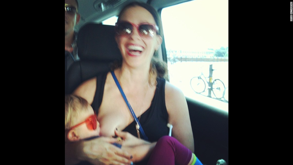 "Singer Alanis Morissette posted this more down to earth photo of herself breastfeeding her son Ever while on tour. <a href=""http://instagram.com/p/rOgEbCOYM3/"" target=""_blank"">Her message</a>: ""family on tour ;) europe 2012 #worldbreastfeedingweek #isupportyou."""