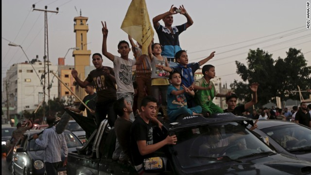 Palestinians celebrate in Gaza a newly agreed upon ceasefire between Israel and Palestine on Tuesday, August 26.