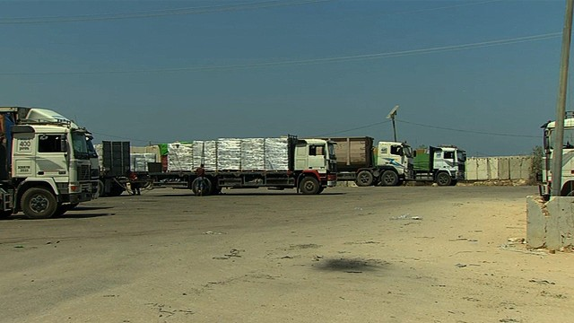 Following reports of a cease-fire agreement between Israel and Hamas, trucks could be seen at the Rafah border crossing between Gaza and Egypt. The trucks carried much needed supplies to Gaza.