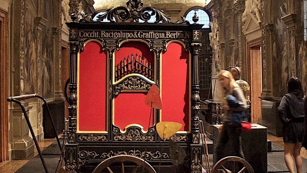 Visitors are encouraged to touch and play with the various musical contraptions. A mobile street organ from late 19th century is pictured.