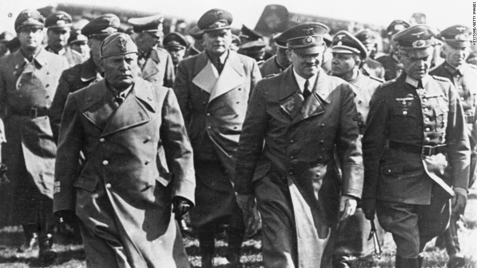 Italian dictator Benito Mussolini, left, with Hitler, center, and other leading Nazis, visits Germany during the war. Italy and Germany formed an alliance before the outbreak of war, but Italy remained a non-belligerent until June 10, 1940, when it declared war on Britain and France. Fighting spread to Greece and North Africa.