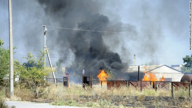 Black smoke billows over fire after shelling on the outskirts of the small southern Ukrainian city of Novoazovsk, Donetsk region, on August 27, 2014.