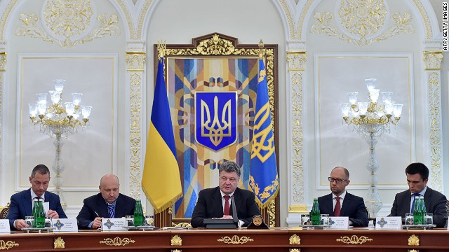 "Ukrainian President Petro Poroshenko (C) speaks as Prime Minister Arseniy Yatsenyuk (2R), Foreign Minister Pavlo Klimkin, Speaker of the Parliament Alexander Turchynov (2L) and the President Chief of Staff Borys Lozhkin (L) attend during the opening of the extraordinary sitting of the National Security and Defence Council in Kiev on August 28, 2014. A senior NATO official said on Thursday that ""well over a thousand"" Russian troops were operating inside Ukraine. ""They support separatists, fighting with them and fighting amongst them, "" the official said on condition of anonymity, adding that the supply of arms by Russia had increased in both ""volume and quality"". AFP PHOTO/ SERGEI SUPINSKYSERGEI SUPINSKY/AFP/Getty Images"
