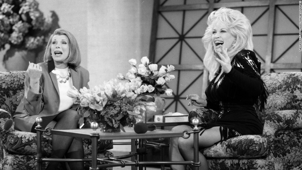 Rivers later hosted talk shows of her own. Here, she chats with Dolly Parton.