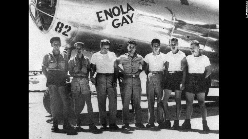 "Col. Paul W. Tibbets Jr., center, stands with the ground crew of the B-29 bomber ""Enola Gay,"" which Tibbets piloted on August 6, 1945. The atomic bomb dropped on Hiroshima, Japan, that day killed an estimated 130,000 people."