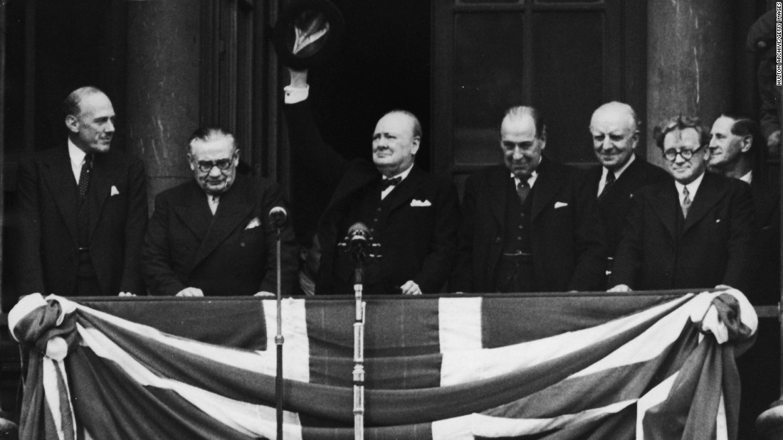 British Prime Minister Winston Churchill addresses the celebrating crowds from the balcony of the Ministry of Health in Whitehall, London, on V-E Day, May 8, 1945. The war in Europe was officially over.