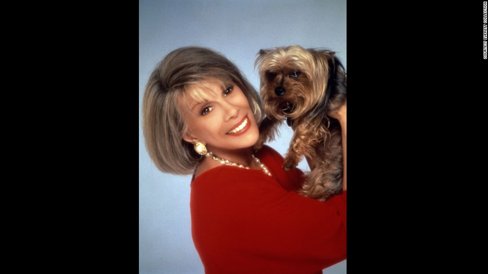 "She starred on the daytime ""Joan Rivers Show,"" for which she won a Daytime Emmy, for five seasons, from 1989-1994. Here, she poses with her dog, Spike."