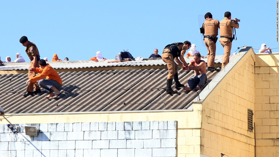 "Security forces storm the roof of a jail where prisoners were gathering in Cascavel, Brazil, on Monday, August 25. <a href=""http://www.cnn.com/2014/08/25/world/americas/brazil-prison-riot/index.html"">Inmates rioting for better living conditions</a> killed four fellow prisoners, decapitating two of them, and held numerous inmates and two guards hostage, officials said."
