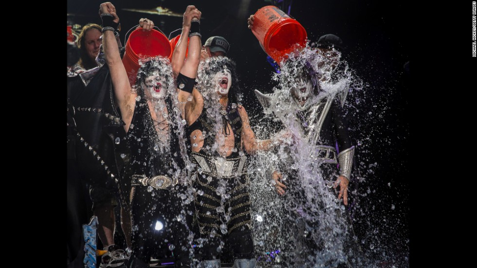 Eric Singer, Paul Stanley and Tommy Thayer of the band KISS participate in the ALS Ice Bucket Challenge on stage in Noblesville, Indiana, on Friday, August 22.