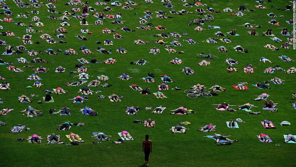 Dozens of people practice yoga on Parliament Hill in Ottawa, Ontario, on Wednesday, August 27.