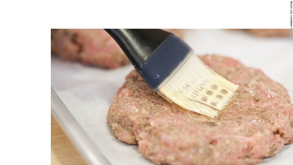 Press shallow indentation into center of each burger. Brush 1 side with vegetable oil and season with kosher salt and pepper. Using tongs, flip patties and repeat on second side.