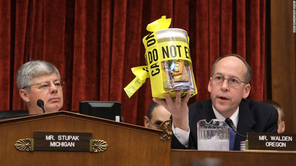 U.S. Rep. Greg Walden, R-Oregon, holds up a jar of peanut products while questioning Stewart Parnell, owner and president of the Peanut Corp. of America, at a salmonella hearing in 2009. Parnell stands accused of deliberately shipping tainted food from his plant in Georgia.