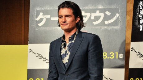 "Orlando Bloom gives a slight smile to the crowd gathered at the press conference for the Japanese premiere of ""Zulu"" on August 27."