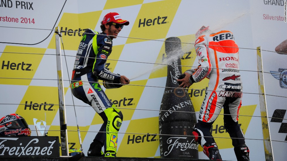 Rossi douses Marquez in champagne after the Spaniard's victory at the British MotoGP.