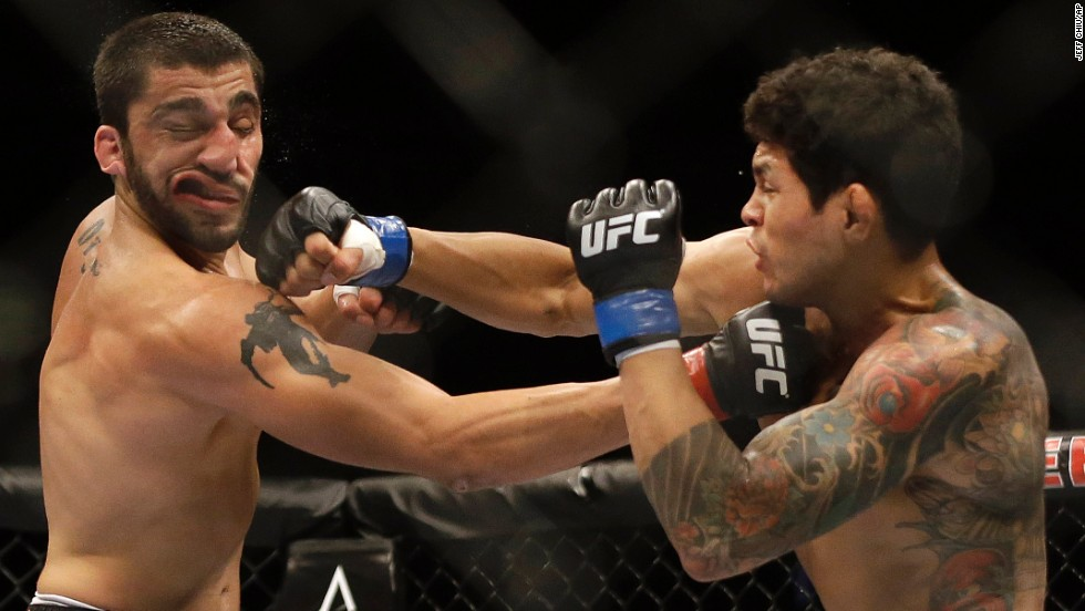 Diego Ferreira, right, punches Ramsey Nijem during their mixed martial arts bout Saturday, August 30, at UFC 177 in Sacramento, California. Ferreira won by a second-round knockout.